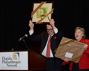 David Odahowski and Sherry Magill react to a standing ovation while being honored at FPN's 2013 Statewide Summit on Philanthropy