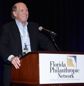 Eckerd Family Foundation President Joe Clark reacts to the announcement of FPN's creation of the Eckerd Next Generation Scholarship for future FPN Summits.